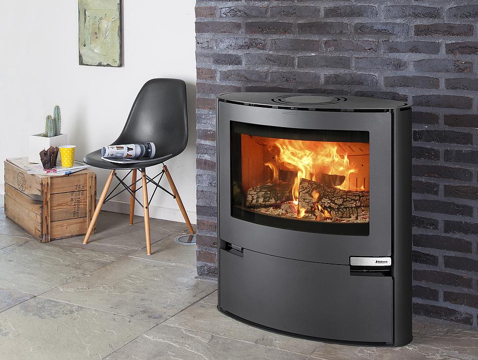 l 39 volution de la vitre des po les bois. Black Bedroom Furniture Sets. Home Design Ideas